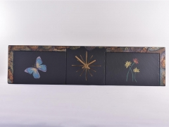 Butterfly and flowers on slate clock