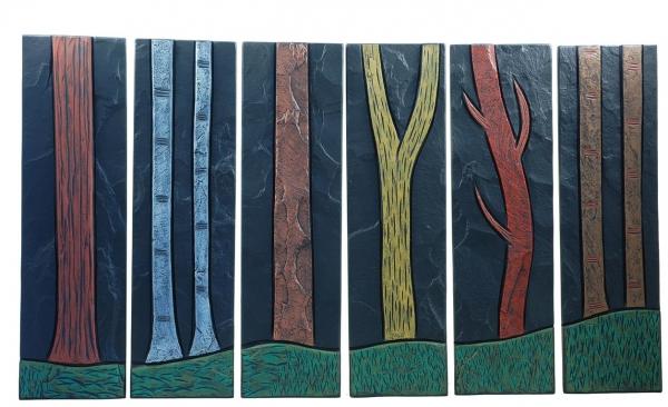 tree trunks on slate