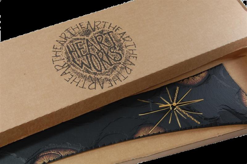 slate pendulum clock in a box