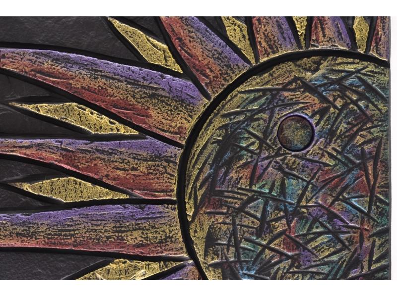 Detail of sun on slate.