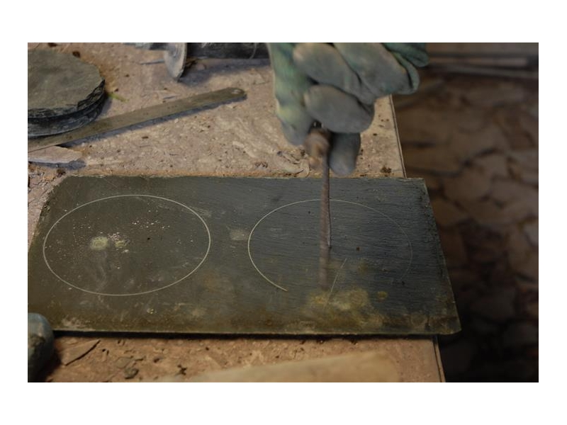 drawing-out-the-outline-on-slate